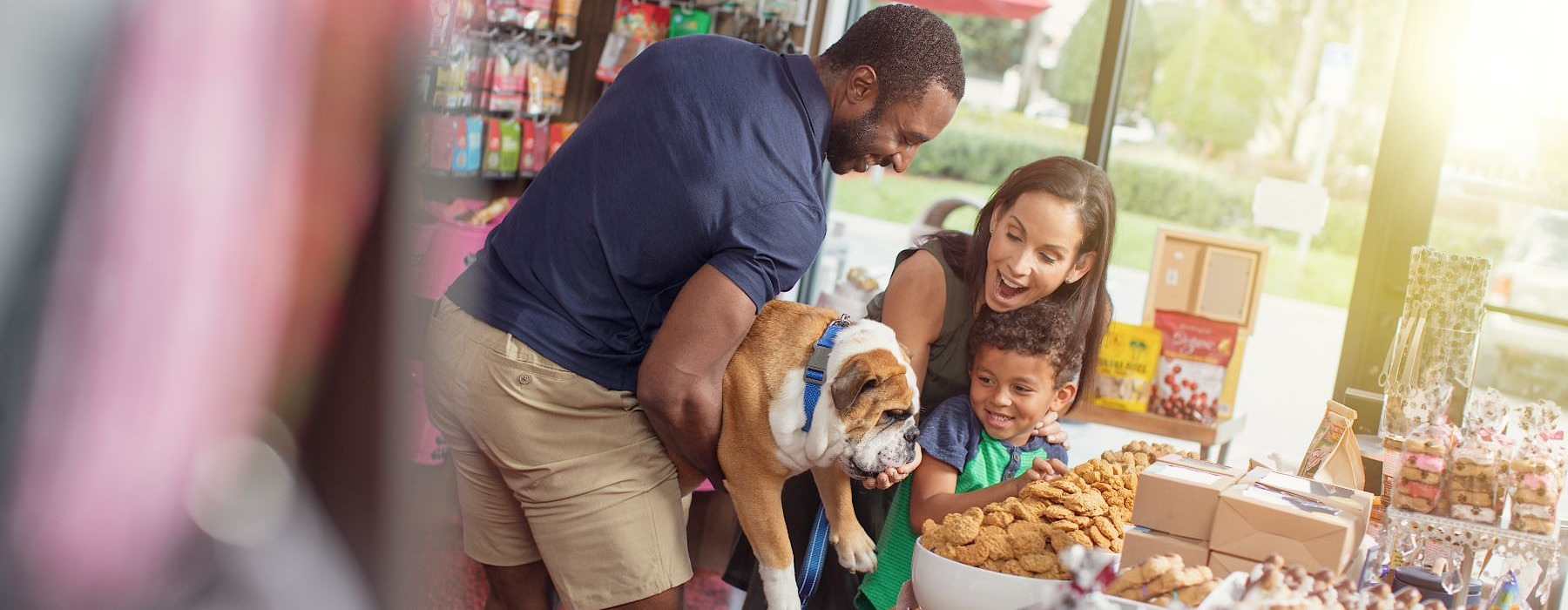 family at dog treat shop