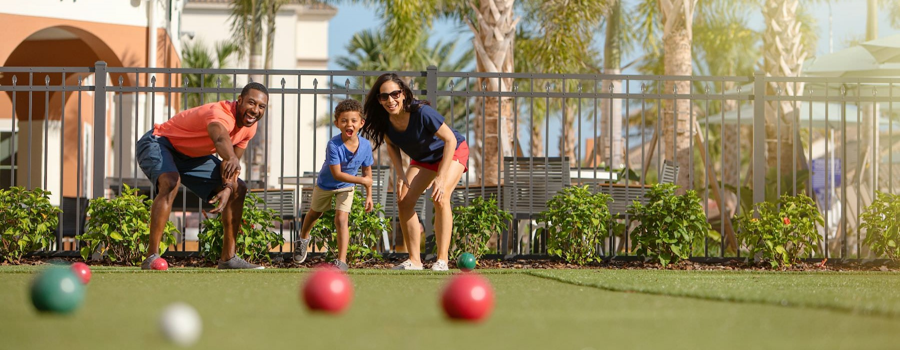 family playing bocce ball